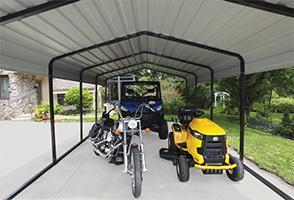 Vehicles under Arrow Carport