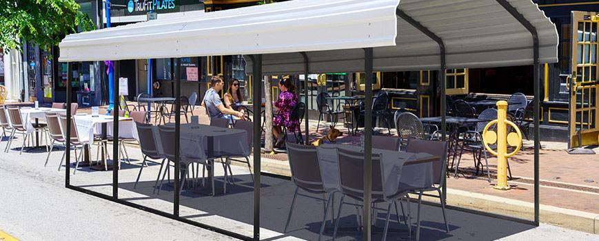 An outdoor carport as a restaurant patio covering